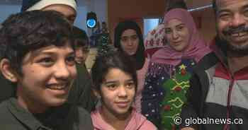 Recent immigrants in Edmonton take part in their first Canadian Christmas celebration