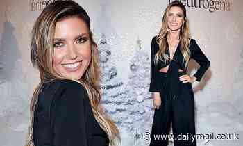 Audrina Patridge gives a hint of her midriff in tied up shirt and slacks at Neutrogena holiday party