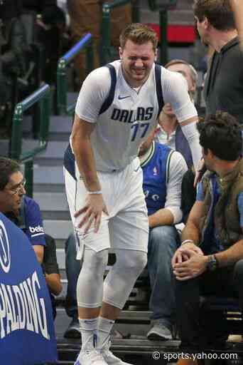Doncic injures ankle, Mavs rally, fall to Heat 122-118 in OT