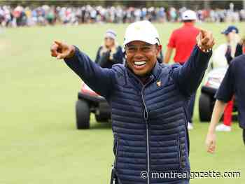 Tiger Woods leads from front as U.S. wins Presidents Cup