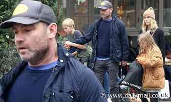 Liev Schreiber takes a stroll in SoHo with girlfriend Taylor Neisen plus sons Sasha and Kai