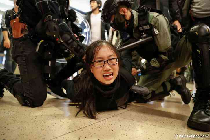 Hong Kong mall protests flare with leader Lam in Beijing