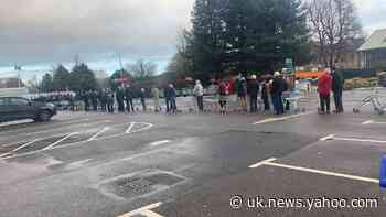 'Angry' residents queue for bottled water as home supplies cut for 48 hours