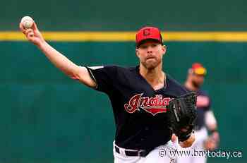 AP source: Indians send Kluber to Texas for DeShields, Clase