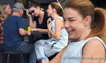 Kate Ritchie manages a smile as she wears her wedding ring to lunch with Chris Hemsworth's parents