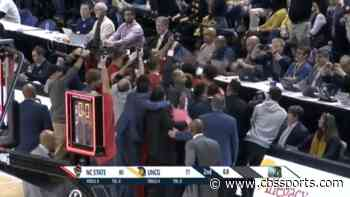WATCH: NC State knocks off UNC Greensboro with dramatic halfcourt heave at the buzzer