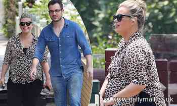 Edwina Bartholomew steps out looking very pregnant while running errands with her husband