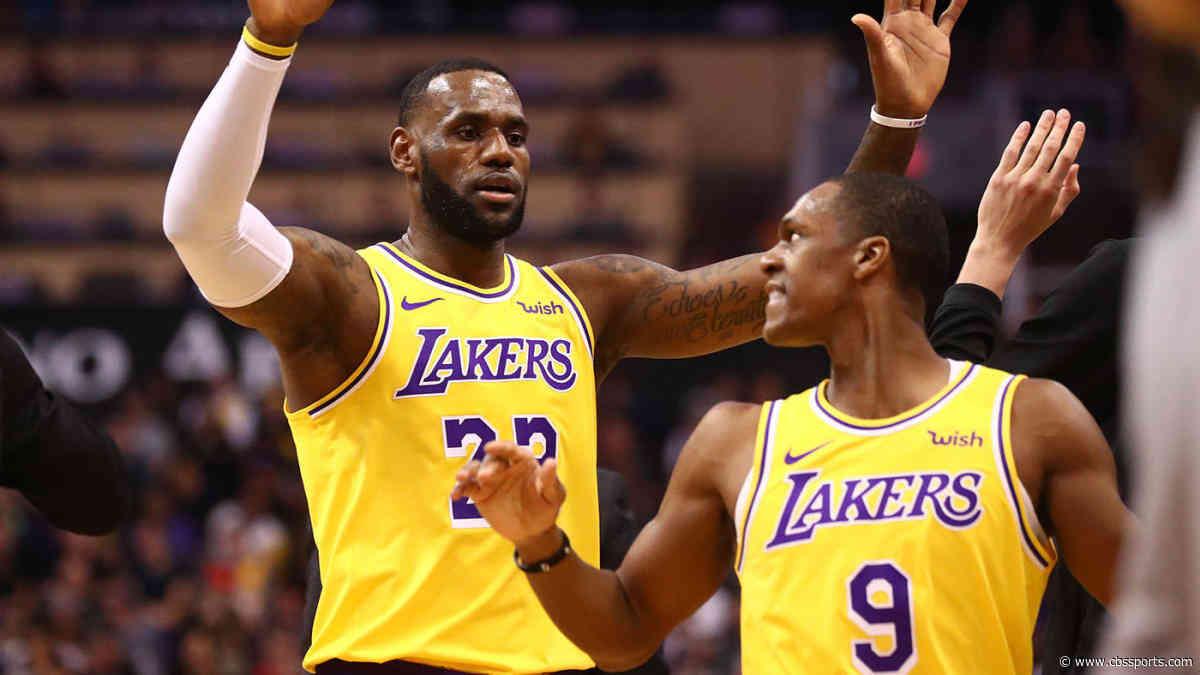 LeBron James jokingly tries to 'block' Rajon Rondo's layup after not receivingalley-ooppass