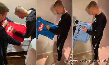 Erling Haaland teases Man United fans by sharing a snap of him signing their shirt