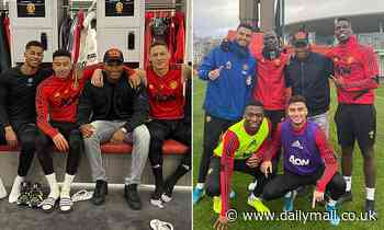Antonio Valencia returns to Manchester United's training base as he poses with former team-mates