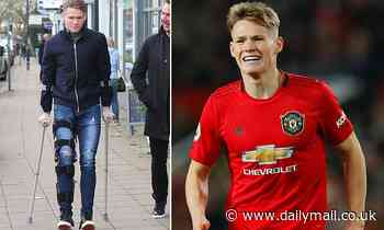 Manchester United midfielder Scott McTominay seen wearing knee brace