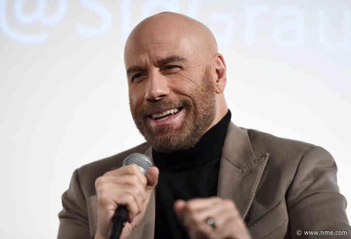 It looks like John Travolta had a lovely time at the Nirvana reunion show