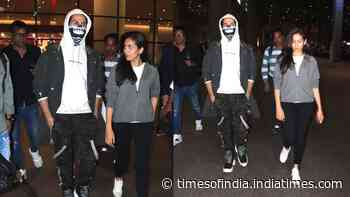 Shahid Kapoor hides his lip injury with skull mask as he returns home with wifey Mira Rajput