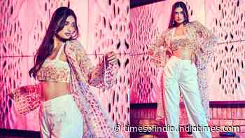 Athiya Shetty flaunts her midriff in this droolworthy floral bralette and white pants