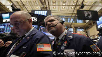 Wall Street opens near record highs ahead of trade deal, earnings