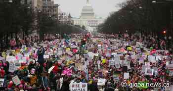 U.S. National Archives apologizes for editing out anti-Trump signs in photo