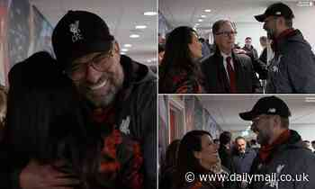 Liverpool owner John W Henry greets Jurgen Klopp after Man United win