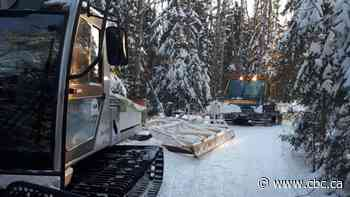 Deep snow a mixed blessing for snowmobilers, trail groomers