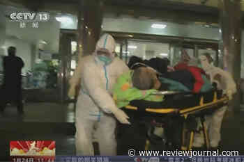 China building hospital to treat virus, expands city lockdowns