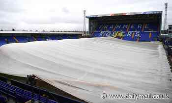 Manchester Utd beware! Tranmere forced to protect waterlogged pitch with giant covers