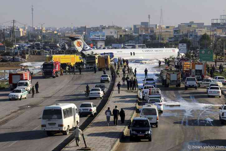 Aging Iran airliner crash-lands on highway, injuring only 2