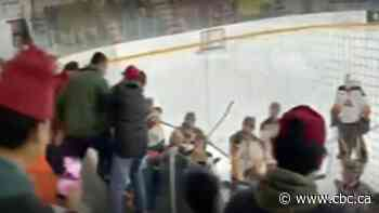 Junior hockey coach caught on video swinging stick at fan says he was protecting his players