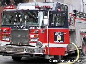 Two-alarm fire damages Pointe-aux-Trembles garage door centre - Montreal Gazette
