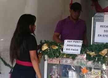 Consumidores de Puerto Ayacucho duermen en colas de negocios para utilizar el petroaguinaldo - El Pitazo