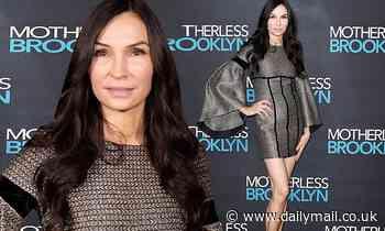 Famke Janssen glows in black-patterned mini-dress at screening of Motherless Brooklyn in London - Daily Mail