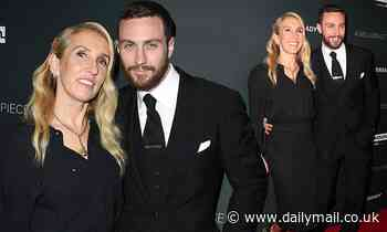 Sam Taylor-Johnson, 52, cosies up to her husband Aaron, 29, at the premiere of their new film - Daily Mail