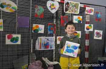 Bussy-Saint-Georges : à 11 ans, Arthur vend ses toiles pour aider les sans-abri - Le Parisien