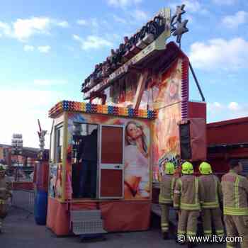 No fun at funfair for thrill-seekers trapped in mid-air - ITV News