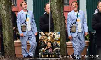 Robert Downey Jr. is spotted out in NYC with a wide grin while critics bash his new film Dolittle - Daily Mail