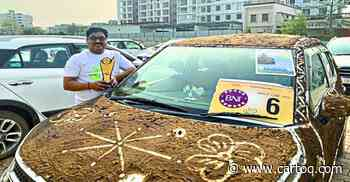 Maruti Suzuki's Ignis hatchback covered with cow dung wins first prize in a car competition - CarToq.com