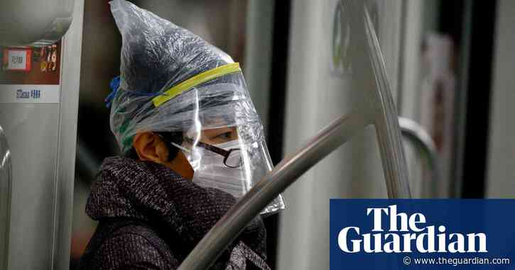 Infection numbers fall in China but coronavirus experts remain cautious