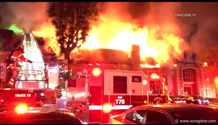 Fire tears through Tustin apartment complex, injuring 2 and displacing 100