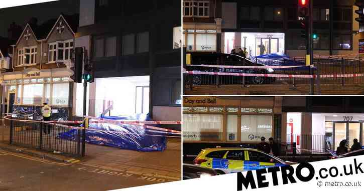Woman arrested after man plunges to death 'from London flat'