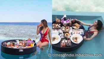 Mouni Roy looks bold and beautiful in this sizzling monokini as she poses in an infinity pool in Maldives
