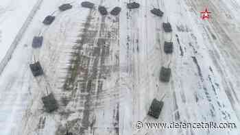 Russian soldier rolls out tanks for romantic maneuver
