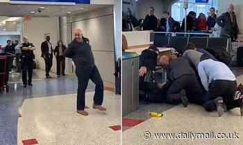 'Out of control' passenger tasered and wrestled to ground by Dallas Fort Worth Airport police