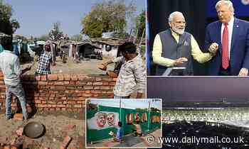 India is hastily building a brick WALL to block Donald Trump's view of the slums