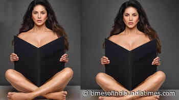Sunny Leone leaves little to the imagination as she goes topless while posing with big black book in new picture
