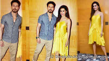 Shraddha Kapoor looks uber cute in her yellow midi dress, Tiger Shroff looks stunning in his blue striped shirt as they promote their upcoming movie 'Baaghi 3'