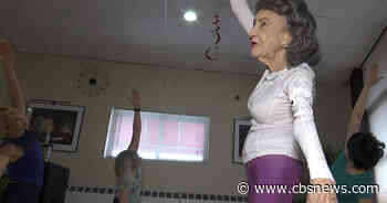 Woman named world's oldest yoga teacher has died at 101