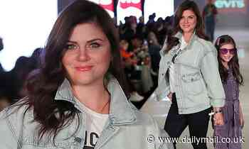 Tiffani Thiessen and her daughter beam while holding hands for a fashion show in Chicago - Daily Mail