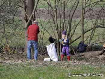 Helfer sammeln Müll an der Pfinz und füllen Container in Keltern - Region - Pforzheimer Zeitung