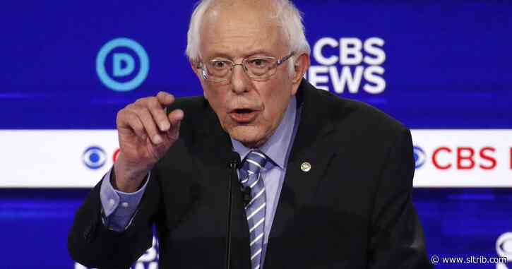 Sanders takes hits while gaining spotlight as front-runner