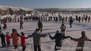 On a frozen Siberian lake, festival-goers mark the Lunar New Year