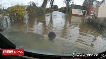 Shropshire 'flood bus' helps people trapped in village