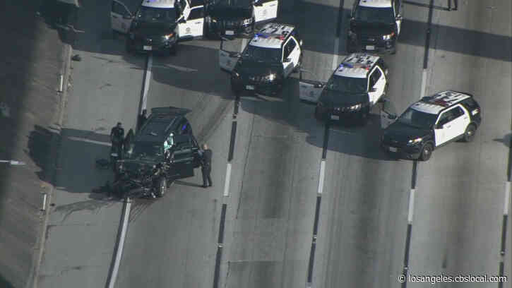 LAPD Pursuit With Stolen Hearse Ends In Wreck On 110 Freeway In South LA; Body Found Inside